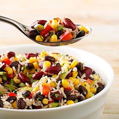 Cool Beans Salad Recipe -This protein-filled dish could be served as a colorful side dish or a meatless main entree. When you make it, double the recipe because it will be gone in a flash! The basmati rice add a unique flavor and the dressing gives it a bit of a tang. —Janelle Lee, Appleton, Wisconsin