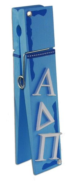 ADPi  Giant Clothes Pin from DIYGreek.com.  Used the Custom Stencil, Wood Letters, Paint, Ribbon and Gem Stones all from the Supply Sack.  Alpha Delta Pi