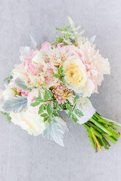 Peony, dahlia, ranunculus, rose, and lamb's ear wedding bouquet: http://www.stylemepretty.com/south-carolina-weddings/charleston/2016/11/10/blush-gold-military-wedding-in-charleston/ Photography: Dana Cubbage - http://danacubbageweddings.com/