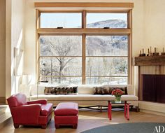The living room in this Stephen Sills–designed Colorado mountain house features an armchair and ottoman of his design, both upholstered in a Ralph Lauren Home leather.
