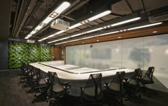 U-shaped meeting table and booths flanked by Herman Miller Sayl and a fresh green walls  Dentsu Aegis Network Offices - Shanghai - Office Snapshots