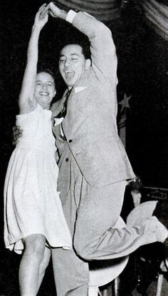 Louis Prima jitterbugs with girl during the playing of Please No Squeeza Da Banana, 1945.