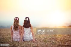 Stock Photo : Two girls sitting watching the sunset