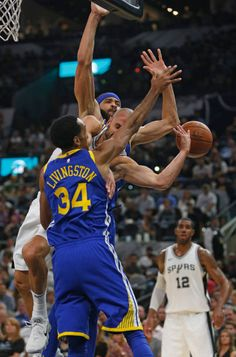 Manu Ginobili of the San Antonio Spurs has his shot blocked by Shaun Livingston of the Golden State Warriors and JaVale McGee of the Golden State...