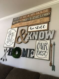 Living room gallery wall. Hey y'all. DIY. Farmhouse decor. Rustic decor. Boxwood wreath.