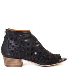 For those cooler Spring and Summer nights, Gidigio Moira is the bootie you want! The perforated leather upper creates a unique effect and a streamline look. Wear skinny black jeans or tights for an elongated look.   FREE Shipping in the contiguous USA Women's flat sandal booties Made in Italy Soft perforated leather upper 100% leather construction Leather sole with rubber heel tap 1 1/2 inch heel Zip-up closure Soft, unlined upper with a streamlined fit Fits true to size Sizing Infor...