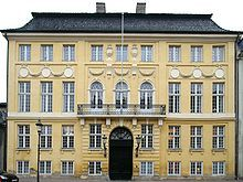 The Yellow Palace (Danish: Det Gule Palæ), or Bergum's Mansion, is a mansion in Amaliegade next to Amalienborg Palace in the Frederiksstaden district of Copenhagen, Denmark. It is considered the first example of Neoclassical architecture in Copenhagen.