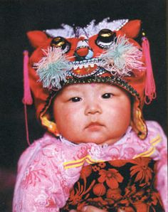 In Guanzhong Region of China, infants and young children are adorned with fabulous little hats embroidered with animal faces. As in many agrarian societies, the mortality rate is high for young children giving rise to a mythology that when demon-spirits looked down and saw a beautiful child, these demons would become jealous and snatch that child away. Thus, the animal hats were an effort to disguise the children, to hide and protect them from jealous demons.