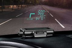 GARMAN Heads Up Display. This portable projector beams navigation information from your bluetooth-equipped smartphone onto a reflective film on your windshield, allowing you to see turn-by-turn directions, time of arrival, distance to the next turn, your speed, the speed limit, traffic information, and more. Just wirelessly pair it with your phone, put your destination into one of the compatible apps, and go. SWEET!!!