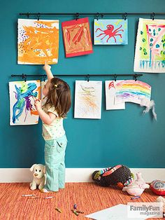 At-Home Art Gallery: Another day, another stack of masterpieces to admire -- and display. Rather than cluttering up the front of the fridge, showcase your kids' artwork on wall-mounted café curtain rods with ring clips, which make adding new work a snap.
