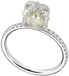 Embrace ring featuring a 2.78ct rough diamond accented with 0.39cts of micro pavé diamonds.