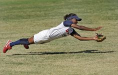 Michelle Moultrie (15), a left-fielder for team U.S.A., dives for a ball...that's how you do it!!!