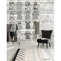 An adorable paper doll pattern is made modern in this black and white exposed wood wall mural.