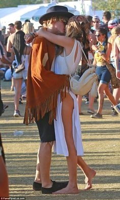 Love's young dream: Gigi Hadid and Cody Simpson shared a romantic kiss on Sunday at the Coachella Music Festival in Indio, California