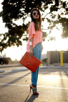 love the asymmetrical shirt, oversize clutch, and stunning shoes!