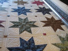 Threads on the floor: Star quilt progress