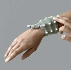 Wearable technology - relieve stress with this cute little thing that hooks around your wrist