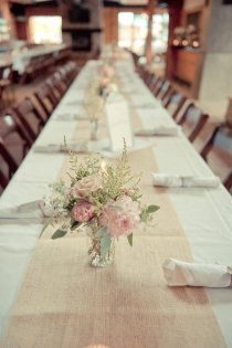 burlap runner, delicate flowers, long table for rehearsal dinner!
