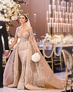 158629520 Bathed in tones of antique gold and nude. Zina took everyone's breath away  wearing custom