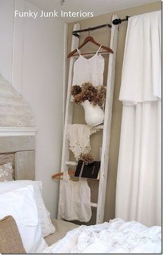 Repurposing Ladders!  use in bedroom to hang clothes from the day or for the next day.  Loving this idea