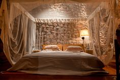 Romantic #Tswalu suite with kingsize bed, Polish linen and mosquito net