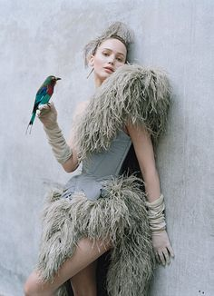 Jennifer Lawrence wears Vivienne Westwood Gold Label ostrich feather and silk dress. Cornelia James gloves.  By Lynn Hirschberg  Photographs by Tim Walker  Styled by Jacob K  September 2012