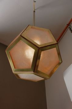 Geometric Pentagon Hanging Lantern | From a unique collection of antique and modern lanterns at http://www.1stdibs.com/furniture/lighting/lanterns/
