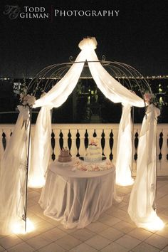 One of our Jewish Weddings we planned and we moved the ceremony chuppah to the cake table! This was an outdoor wedding so it was perfect with the lighting.- Days Remembered by ND