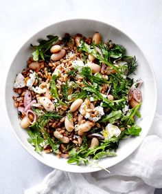 White Bean and Farro Salad | You'll be amazed at how quickly this weeknight meal comes together. As the farro cooks, you'll slice a shallot, crumble some feta, and chop a bit of dill.