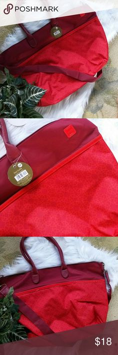 Weekender duffle bag Gorgeous red and maroon duffle bag brand new with tags some white small amount of white shredding shown in pictures but gorgeous bag with crossbody strap Bags Totes