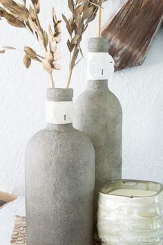 Who knew you could Mod Podge sand?! These beachy sand covered bottles are quick and easy to make with just some sand, Mod Podge, and empty bottles!