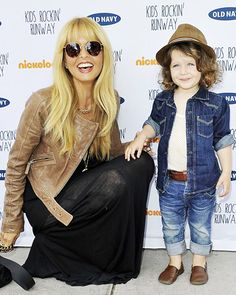Rachel Zoe's outfit is adorable. Her son looks wacky!