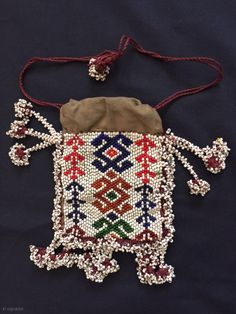 a beautiful antique glass bead woven Central Asian bag from Nuristan region of Afghanistan. Ethnographic arts of Nuristan (be it textiles or wood artefacts) are very distinct in comparison to other ethnic  ...