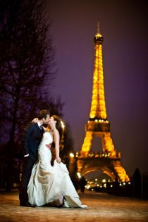 First Kiss in front of the Eiffel Tower  www.girlsguidetoparis.com
