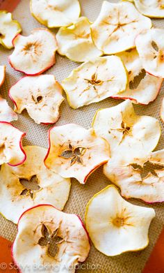 Crunchy, simple, healthy Baked Apple Chips. These are so addicting and all you are eating is apples! @sallybakeblog