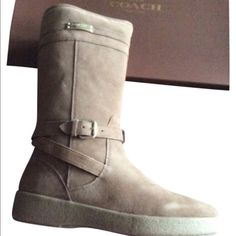 """Coach Suede and Sherling Boots Shaft measures approximately 11.5"""" from arch Suede with faux-shearling lining Coach logo hardware design Buckle straps around ankle for an equestrian-inspired style 11-1/2"""" height, 13-3/4"""" circumference (may vary by size) Rubber sole Coach Shoes Winter & Rain Boots"""