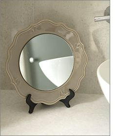 DIY - Plate Stand Mirror like this idea, very sweet for dresser or bathroom  Tutorial.