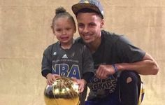 eb01896f5838 Riley Curry says  my turn  while Steph takes photos with trophy