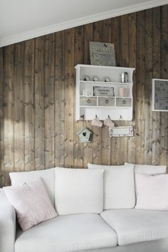 wooden wall and white shelves