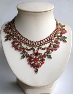 Very graceful, would also look gorgeous in whites for a wedding statement piece. -M