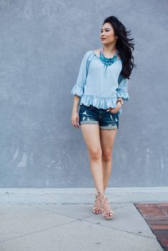 Denim on Denim with a ruffled chambray top and distressed jeans
