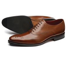 Stylish oxford shoe made from soft calf leather, featuring fine punched toe detail and a Goodyear Welted sole with a rubber forepart. Handcrafted in India.
