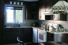 kitchen?? -  Love the cabinets and counter top.  The light fixture over the sink is identical to the one in the bathroom.