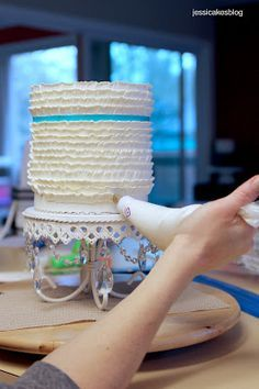 How to make Buttercream Frills (or Ruffles) Cake. Use tip No. 125 to pipe layers of buttercream ruffles