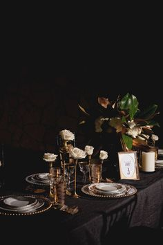 love the roses on top of the candlesticks-Old Hollywood Glam Wedding Inspiration