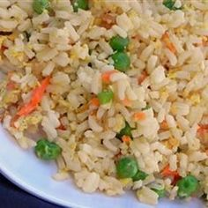 "Fried Rice Restaurant Style | ""I have learned that I must double or even triple this recipe because everyone who tries it...can't get enough of it! It is better than any restaurant I've ever been to!"" #worldcuisine #internationalrecipes #globalrecipes #regionalrecipes"