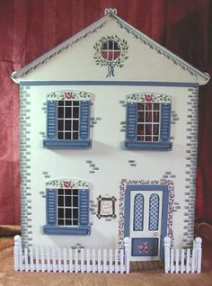 Rose Cottage handpainted dollhouse (hand painted exterior and fabric used for wallpaper - click to see pics)