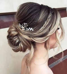 How gorgeous is this hairstyle? I'm loving the braid detail and the peek-a-boo baby's breath! sexyhair.com #babyhairstyles