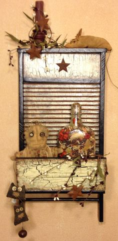 Washboard I found, I crackled it and found lots of goodies to decorate it with , makes a great Christmas gift