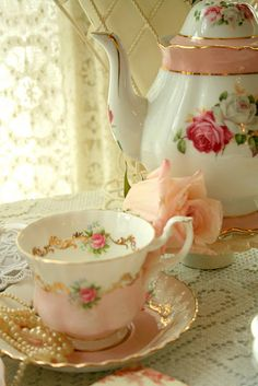 Tea set with beautiful rose pattern...I own and love my great grandmother's porcelin tea set. Very elegant pattern not like today's.